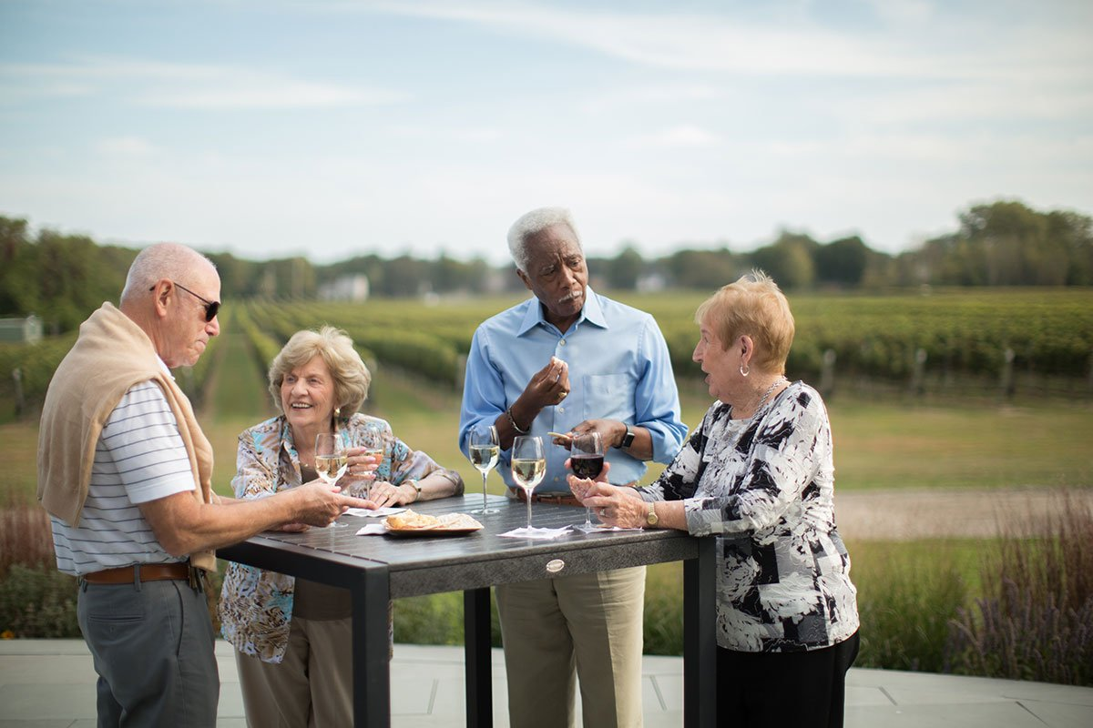Gathering-at-winery-table