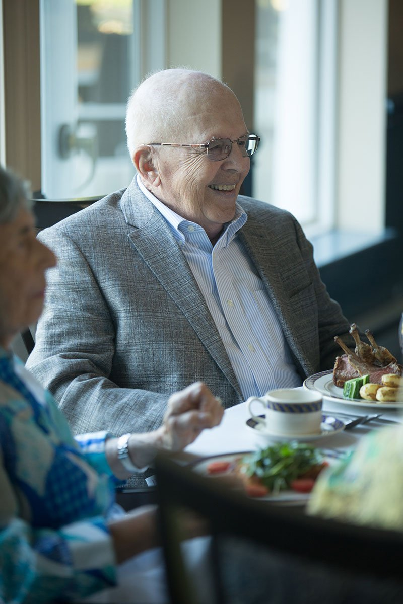 Man-at-table-smiling